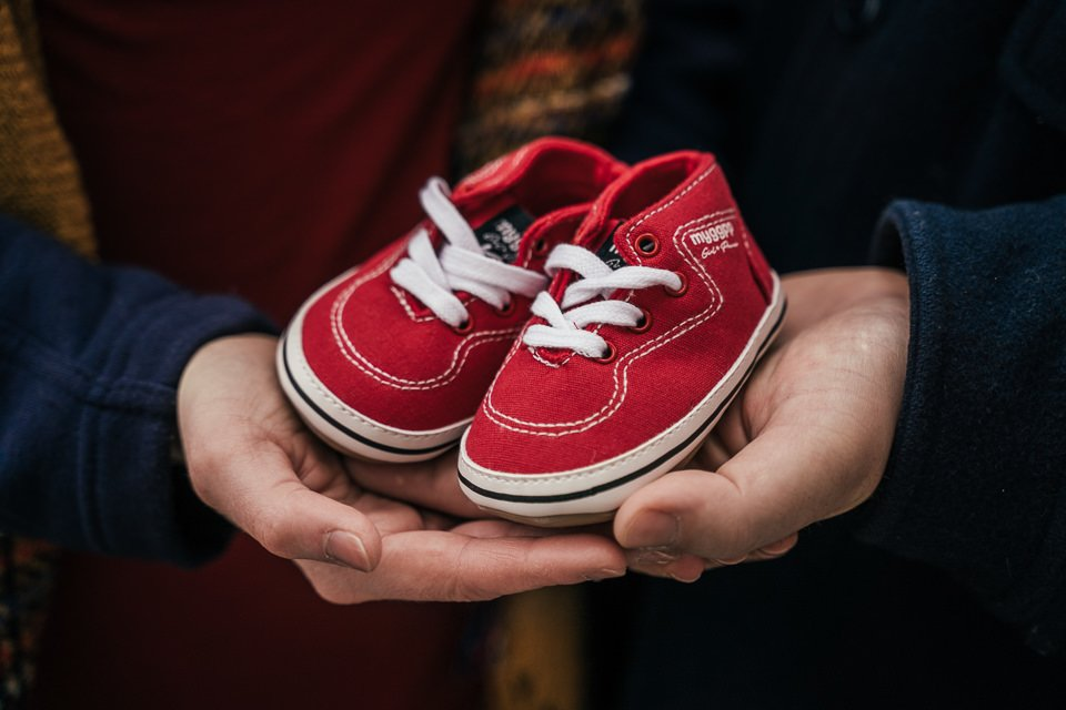 baby shoes help convey the message as a baby annoucement photoshoot in Krakow is also about the details